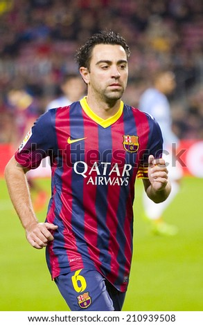 BARCELONA - JANUARY 26: Xavi Hernandez of FCB in action at Spanish league match between FC Barcelona and Malaga CF, final score 3-0, on January 26, 2014, in Barcelona, Spain. - stock photo