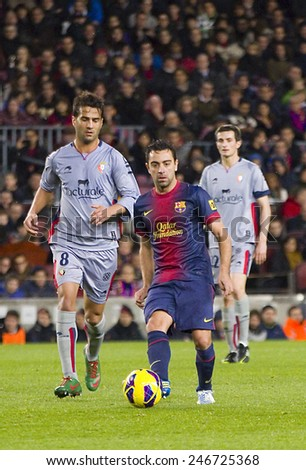 BARCELONA - JANUARY 27: Xavi Hernandez of FCB (middle) in action at the Spanish League match between FC Barcelona and Osasuna, final score 5 - 1, on January 27, 2013, in Barcelona, Spain. - stock photo