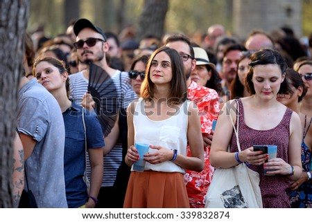 BARCELONA - JUL 4: The spectators watch a concert at Vida Festival on July 4, 2015 in Barcelona, Spain. - stock photo