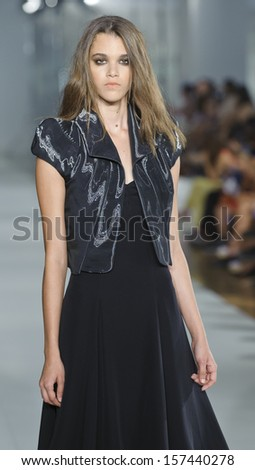 BARCELONA - JULY 10: A model walks on the Shipper Arques catwalk during the 080 Barcelona Fashion runway on July 10, 2013 in Barcelona, Spain.
