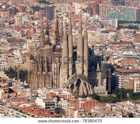 BARCELONA - JULY 7: Aerial view of Sagrada Familia before the visit of th Pope Benedict XVI to consecrate this cathedral, designed by Catalan architect Antoni Gaudi. July 7, 2010 in Barcelona, Spain. - stock photo