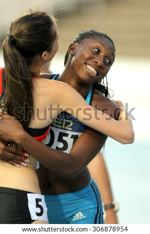 BARCELONA - JULY, 11: Anthonique Strachan of Bahamas celebrates gold of 100m event the 20th World Junior Athletics Championships at the Olympic Stadium on July 11, 2012 in Barcelona, Spain - stock photo