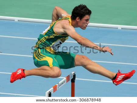 BARCELONA - JULY, 11: Bernardus Pretorius of South Africa during  400m hurdles event of the 20th World Junior Athletics Championships at the Olympic Stadium on July 11, 2012 in Barcelona, Spain - stock photo