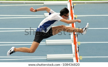 BARCELONA - JULY, 10: Ching Yeung Mui of Hong Kong warming up before 110 meters hurdles of the 20th World Junior Athletics Championships at the Olympic Stadium on July 10, 2012 in Barcelona, Spain - stock photo