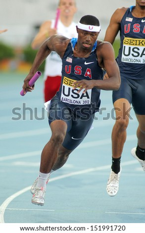 BARCELONA - JULY, 14: Eric Futch of USA competes on 4X400 Relay of the 20th World Junior Athletics Championships at the Olympic Stadium on July 14, 2012 in Barcelona, Spain - stock photo