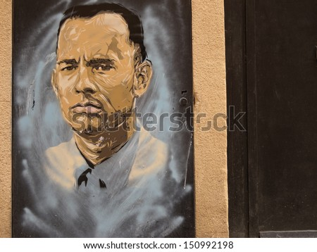 BARCELONA - JULY 18: Graffiti in honor Tom Hanks on July 18, 2013 in Barcelona, Spain. Tom Hanks is the only author who has won 2 row Oscars for Best Actor in second half XXth c. - stock photo