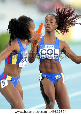 BARCELONA - JULY, 14: J. Largacha(R) and E. Aguilar(L) of Colombia competes on 4X400 Relay of the 20th World Junior Athletics Championships at the Olympic Stadium on July 14, 2012 in Barcelona, Spain - stock photo
