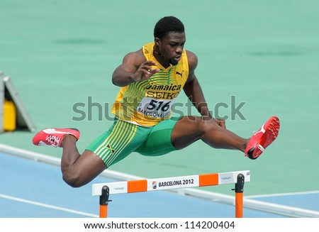 BARCELONA - JULY, 11: Jarvan Gallimore of Jamaica during 400m hurdles event of the 20th World Junior Athletics Championships at the Olympic Stadium on July 11, 2012 in Barcelona, Spain - stock photo