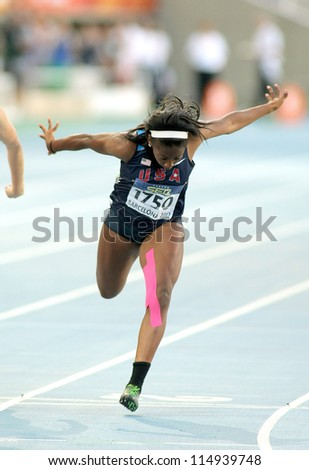 BARCELONA - JULY, 11: Jennifer Madu of USA during 100 metres event of the 20th World Junior Athletics Championships at the Olympic Stadium on July 11, 2012 in Barcelona, Spain - stock photo