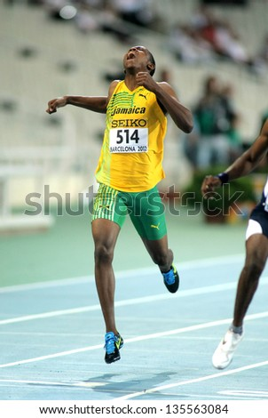 BARCELONA - JULY, 13: Julian Forte of Jamaica sprinting during the 20th World Junior Athletics Championships at the Olympic Stadium on July 13, 2012 in Barcelona, Spain - stock photo