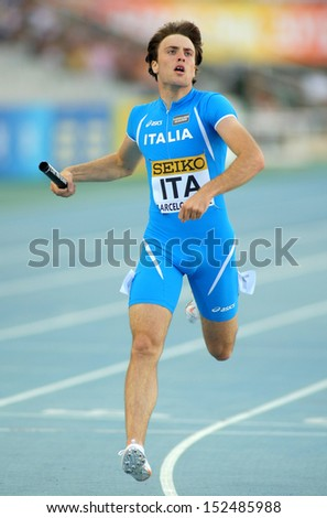 BARCELONA - JULY, 14: Michele Tricca of Italy competes on 4X400 Relay of the 20th World Junior Athletics Championships at the Olympic Stadium on July 14, 2012 in Barcelona, Spain - stock photo
