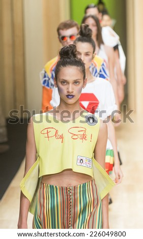 BARCELONA - JULY 03: models walking on the Brain & Beast catwalk during the 080 Barcelona Fashion runway Spring/Summer 2015 on July 03, 2014 in Barcelona, Spain.  - stock photo
