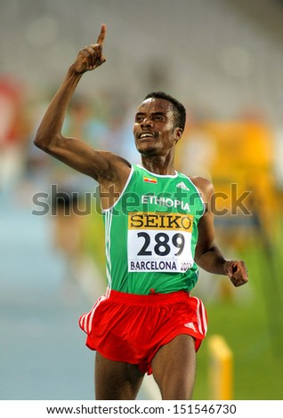 BARCELONA - JULY, 14: Muktar Edris of Ethiopia celebrates his victory on 5000 meters of the 20th World Junior Athletics Championships at the Olympic Stadium on July 14, 2012 in Barcelona, Spain - stock photo