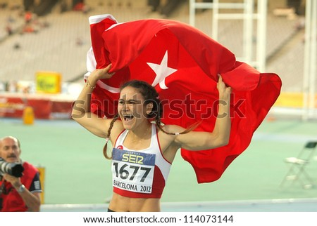 BARCELONA - JULY, 11: Nimet Karakus of Turkey celebrates silver medal of 100m event of the 20th World Junior Athletics Championships at the Olympic Stadium on July 11, 2012 in Barcelona, Spain - stock photo