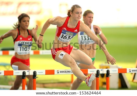 BARCELONA - JULY, 14: Noemi Zbaren of Switzerland during 100 meters hurdles of the 20th World Junior Athletics Championships at the Olympic Stadium on July 14, 2012 in Barcelona, Spain - stock photo