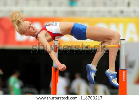 BARCELONA - JULY, 13: Oksana Krasnokutskaya of Russia jumping on Hight jump event of of the 20th World Junior Athletics Championships at the Olympic Stadium on July 13, 2012 in Barcelona, Spain