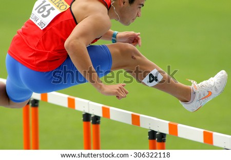 BARCELONA - JULY, 10: Patricio Colarte of Chile during 110m hurdles event of the 20th World Junior Athletics Championships at the Olympic Stadium on July 10, 2012 in Barcelona, Spain - stock photo
