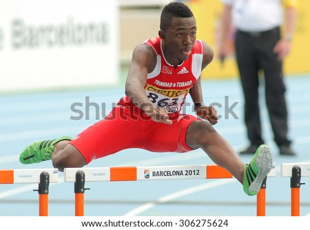 BARCELONA - JULY, 10: Ruebin Walters of Trinidad & Tobago during 110m hurdles event of the 20th World Junior Athletics Championships at the Olympic Stadium on July 10, 2012 in Barcelona, Spain - stock photo