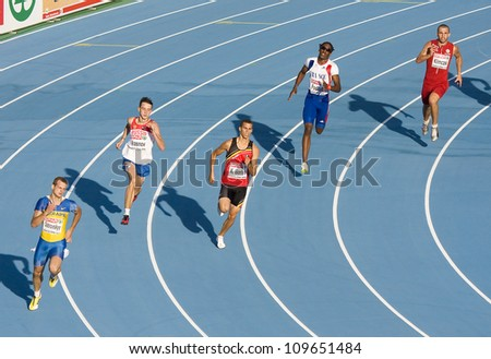 BARCELONA - JULY 28: Some unidentified athletes running at semi-final of 400 meters for men during European Athletics Championships Barcelona 2010, on July 28, 2010 in Barcelona, Spain. - stock photo