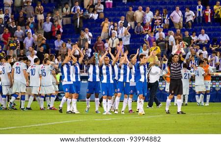 BARCELONA - JULY 27: Spanish players celebrates a goal during the Ciutat de Barcelona Trophy match between Espanyol and Boca Juniors, 3 - 1, on July 27 2010 in Cornella stadium, Barcelona, Spain. - stock photo