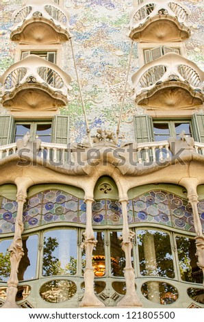 BARCELONA - JULY 19: The facade of the house Casa Battlo (also could the house of bones) designed by Antoni Gaudi with his famous expressionistic style on July 19, 2012 Barcelona, Spain - stock photo