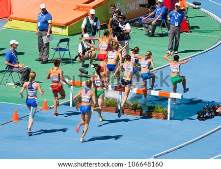 BARCELONA - JULY 28: Unidentified women athletes compete at the semi-final of 3000 meter steeplechase during 2010 European Athletics Championships Barcelona on July 28, 2010 in Barcelona, Spain. - stock photo