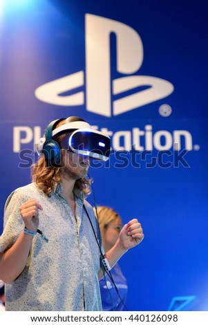 BARCELONA - JUN 16: A man tries the Playstation VR (Virtual Reality) glasses at Sonar Festival on June 16, 2016 in Barcelona, Spain. - stock photo