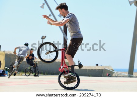 BARCELONA - JUN 28: A professional rider at the BMX (Bicycle motocross) Flatland competition at LKXA Extreme Sports Barcelona Games on June 28, 2014 in Barcelona, Spain.