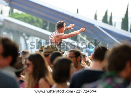 BARCELONA - JUN 12: Audience at Sonar Festival on June 12, 2014 in Barcelona, Spain. - stock photo