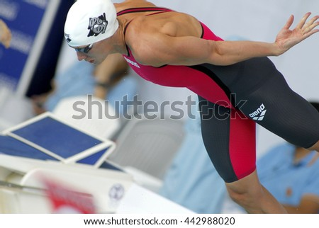 BARCELONA - JUN, 11: Hungarian swimmer Katinka Hosszu jumps into the water during the Trophy Ciutat de Barcelona in Sant Andreu Club, June 11, 2016 in Barcelona, Spain - stock photo