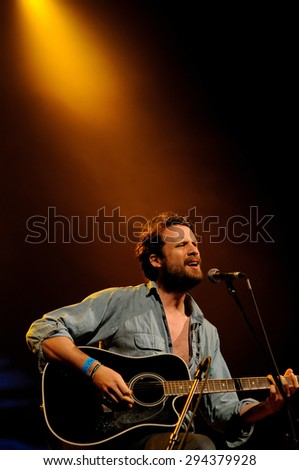 BARCELONA - JUN 2: Josh Tillman, singer and guitarist of Father John Misty (band), performs at San Miguel Primavera Sound Festival on June 2, 2012 in Barcelona, Spain. - stock photo