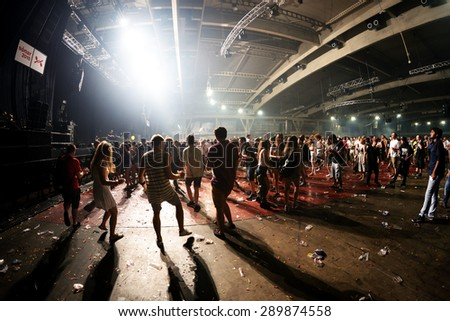 BARCELONA - JUN 19: People dance in an electronic concert at Sonar Festival on June 19, 2015 in Barcelona, Spain. - stock photo