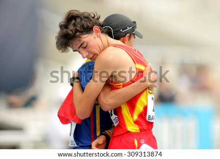 BARCELONA-JUNE, 13: Alvaro Martin of Spain and Eider Arevalo embraces when finished an event of of the World Junior Athletics Championships at the Olympic Stadium on July 13, 2012 in Barcelona, Spain - stock photo