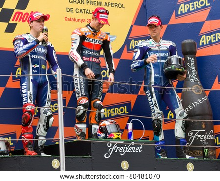 BARCELONA - JUNE 5: Casey Stoner (1st), Jorge Lorenzo (2nd) and Ben Spies (3rd) in the podium after the race of MotoGP Grand Prix of Catalunya, on June 5, 2011 in Barcelona, Spain. - stock photo