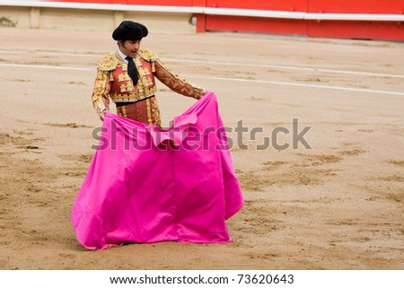"""BARCELONA - JUNE 6: """"Corrida"""" (bullfight) of bulls, a typical Spanish tradition where a torero (bullfighter) kills a bull. In the picture, """"Morante de la Puebla"""". June 6, 2010 in Barcelona (Spain). - stock photo"""