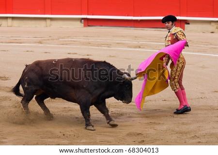 """BARCELONA - JUNE 6: """"Corrida"""" (bullfight) of bulls, typical Spanish tradition where a torero (bullfighter) kills a bull. In the picture, """"Morante de la Puebla"""". June 6, 2010 in Barcelona (Spain). - stock photo"""