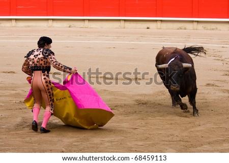 "BARCELONA - JUNE 6: ""Corrida"" (bullfighting) of bulls, typical Spanish tradition where a torero (bullfighter) kills a bull. In the picture, ""Rafael Cuesta"". June 6, 2010 in Barcelona (Spain). - stock photo"