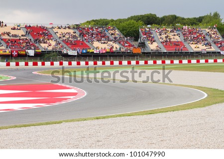 BARCELONA - JUNE 4: Crowd of people watching the Qualifying Session of Moto 125 Grand Prix of Catalunya, on June 4, 2011 in Barcelona, Spain. - stock photo