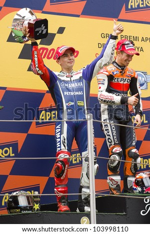 BARCELONA - JUNE 5: Jorge Lorenzo (2nd) celebrating his trophy in the podium after the race of MotoGP Grand Prix of Catalunya, on June 5, 2011 in Barcelona, Spain. - stock photo