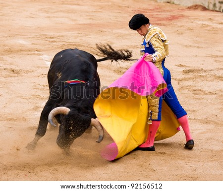 BARCELONA - JUNE 6: Julian Lopez El Juli in action during a corrida de toros or bullfight, typical Spanish tradition where a torero or bullfighter kills a bull on June 6, 2010 in Barcelona, Spain. - stock photo