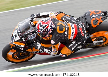 BARCELONA - JUNE 3: Marc Marquez racing at the race of Moto2 Grand Prix of Catalunya, on June 3, 2012 in Barcelona, Spain. The winner was Andrea Iannone. - stock photo