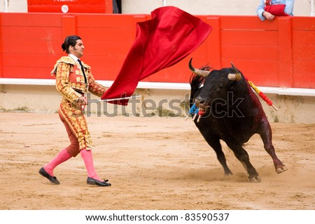 BARCELONA - JUNE 6: Morante de la Puebla in action during a corrida de toros or bullfight, typical Spanish tradition where a torero or bullfighter kills a bull on June 6, 2010 in Barcelona, Spain. - stock photo