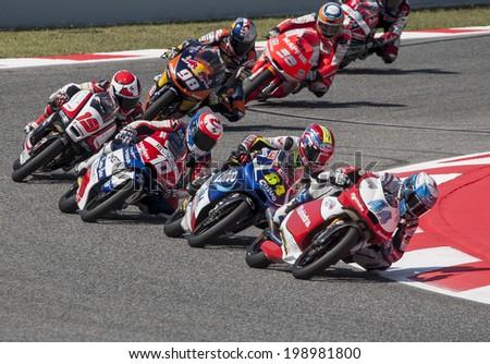 BARCELONA - JUNE 15: Moto 3 start at GP CATALUNYA MOTO GP at Catalunya Circuit on June 15, 2014 in Barcelona, Spain.  - stock photo