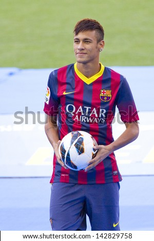 BARCELONA - JUNE 3: Neymar Junior, a FC barcelona new player, poses for the photographers during his official presentation at the Camp Nou stadium , on June 3, 2013, in Barcelona, Spain. - stock photo