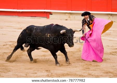 BARCELONA - JUNE 6: Rafael Cuesta in action. June 6, 2010 in Barcelona, Spain. Corrida or bullfighting, typical Spanish tradition where a torero or bullfighter kills a bull. - stock photo