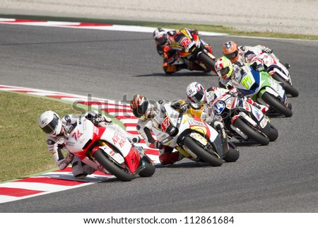 BARCELONA - JUNE 2: Some riders racing at Qualifying Session of Moto2 Grand Prix of Catalunya, on June 2, 2012 in Barcelona, Spain. - stock photo