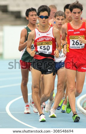 BARCELONA - JUNE, 13: Takumi Saito of Japan during 10000 metres race walk event of of the 20th World Junior Athletics Championships at the Olympic Stadium on July 13, 2012 in Barcelona, Spain - stock photo