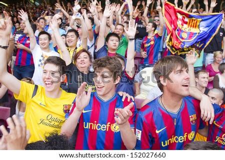 BARCELONA - JUNE 3: Unidentified supporters during Brazilian footballer Neymar Da Silva Santos Junior official presentation as new FC Barcelona player, on June 3, 2013, in Barcelona, Spain. - stock photo