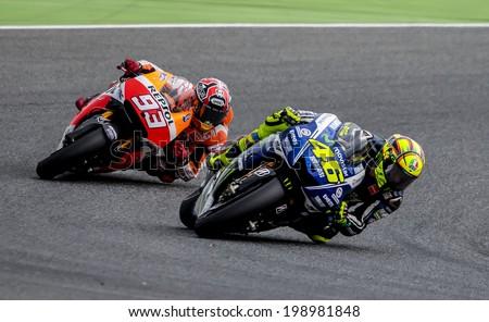 BARCELONA - JUNE 15: Valentino Rossi and Marc Marquez at GP CATALUNYA MOTO GP at Catalunya Circuit on June 15, 2014 in Barcelona, Spain.  - stock photo