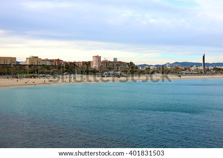 Barcelona landscape, view from Port Olimpic on Mediterranean sea, Playa de la Nova Icaria and skyscrapers.